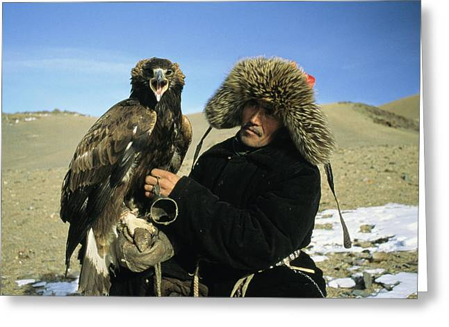 Falconry And Falconry Equipment Greeting Cards - A Kazakh Eagle Hunter Poses Greeting Card by Ed George