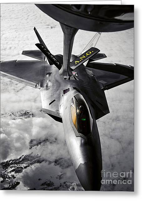 Refueling Greeting Cards - A Kc-135 Stratotanker Refuels A F-22 Greeting Card by Stocktrek Images