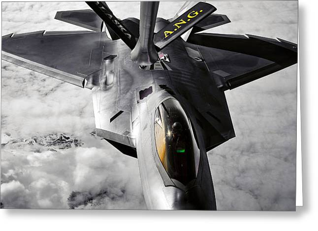 A Kc-135 Stratotanker Refuels A F-22 Greeting Card by Stocktrek Images