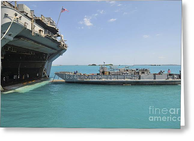 Uss Essex Greeting Cards - A Landing Craft Utility Approaches Greeting Card by Stocktrek Images