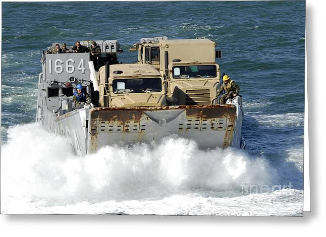 Landing Craft Greeting Cards - A Landing Craft Utility Transports Greeting Card by Stocktrek Images