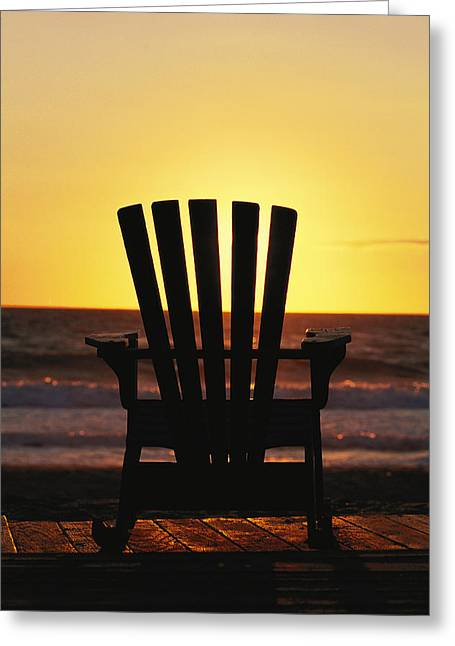 Benches And Chairs Greeting Cards - A Lawn Chair On A Beach At Sunset Greeting Card by Steve Winter