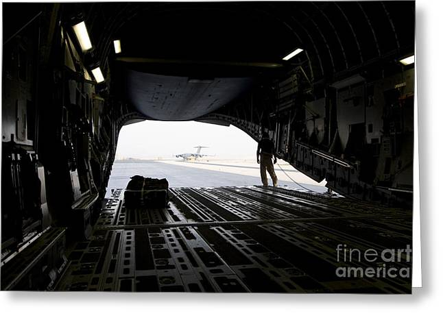 Airfield Greeting Cards - A Loadmaster Guides The Pilot Of A C-17 Greeting Card by Terry Moore