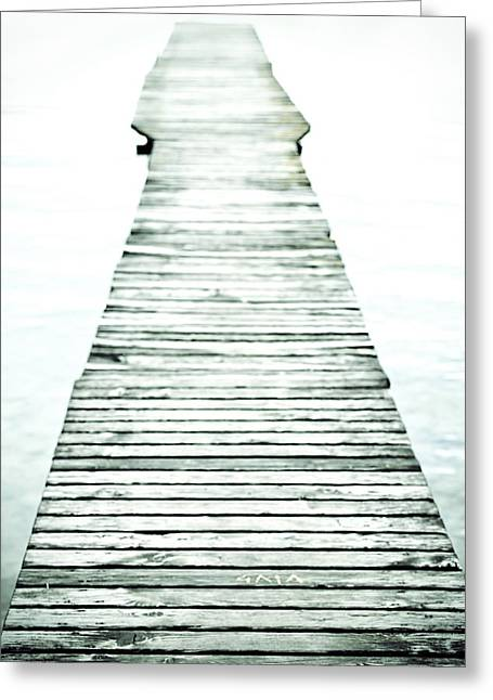 Lighting Greeting Cards - A long and old wooden bridge into the bright light Greeting Card by Joana Kruse