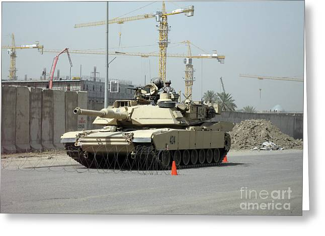 Baghdad Greeting Cards - A M1 Abram Sits Out Front Of The New Greeting Card by Terry Moore