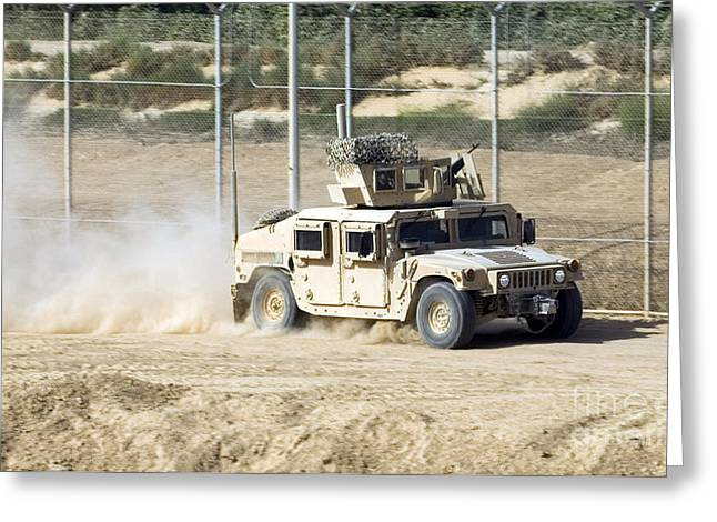 M1114 Greeting Cards - A M1114 Humvee Patrols The Perimeter Greeting Card by Stocktrek Images