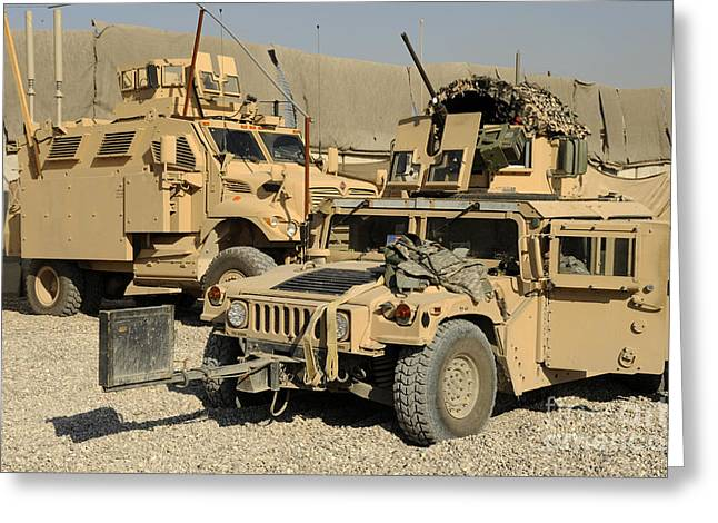 M1114 Greeting Cards - A M1114 Humvee Sits Parked In Front Greeting Card by Stocktrek Images