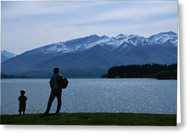 Family With One Child Greeting Cards - A Man And Small Boy Gaze At Lake Wanaka Greeting Card by Todd Gipstein