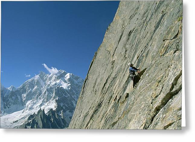 Standing Out From The Crowd Greeting Cards - A Man Climbing Near Naysar Pass Greeting Card by Jimmy Chin