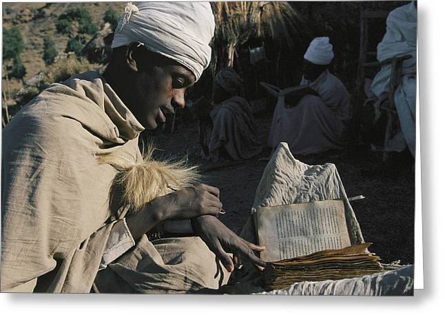 African Clothing Greeting Cards - A Man In A Turban Sits Reading Outside Greeting Card by Michael S. Lewis