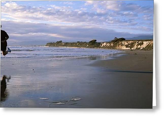 Gaviota Greeting Cards - A Man Jogs Along Sands Beach Greeting Card by Rich Reid