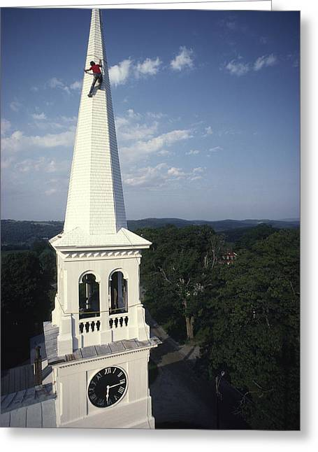Church Painter Greeting Cards - A Man Paints The Steeple Of A Vermont Greeting Card by Michael Melford