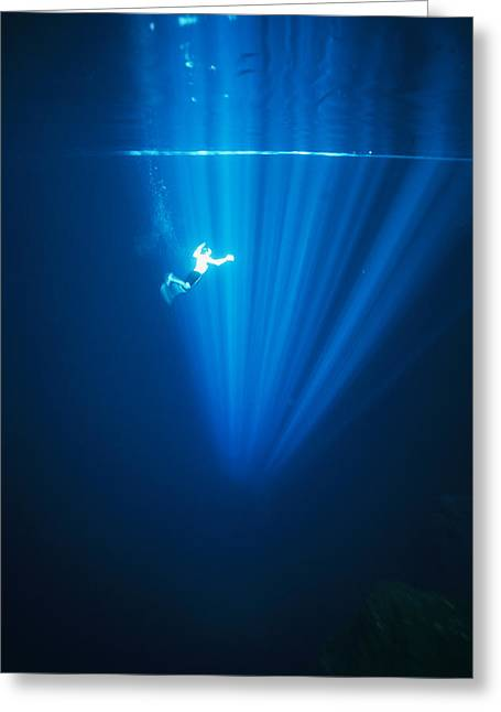A Man Swims Under A Beam Of Light Greeting Card by Stephen Alvarez