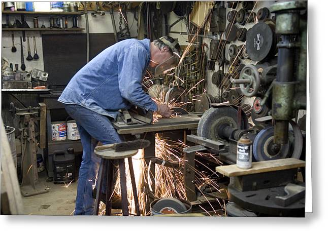 Model Release Greeting Cards - A Man Works In His Shop On A Family Greeting Card by Joel Sartore