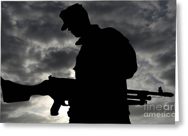 General Purpose Machine Guns Greeting Cards - A Marine Attaches An M-240g Medium Greeting Card by Stocktrek Images