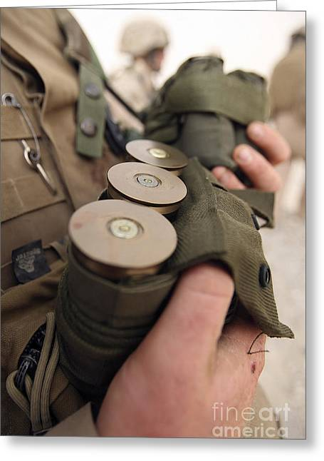 40mm Greeting Cards - A Marine Cradles Handfuls Of 40 Mm Greeting Card by Stocktrek Images