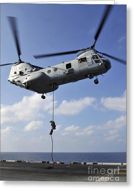 Fast-roping Greeting Cards - A Marine Fast Ropes From A Ch-46e Sea Greeting Card by Stocktrek Images