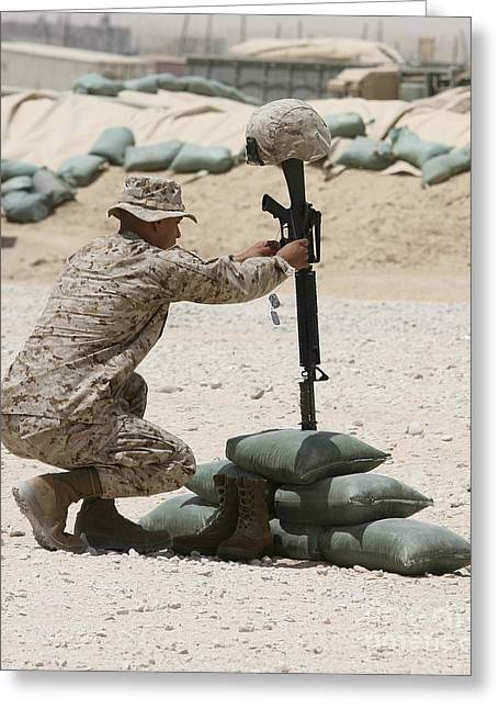 Bravery Greeting Cards - A Marine Hangs Dog Tags On The Rifle Greeting Card by Stocktrek Images