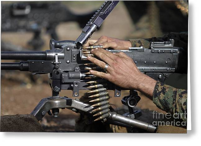 Hand Fed Greeting Cards - A Marine Loads A M-240g Machine Gun Greeting Card by Stocktrek Images