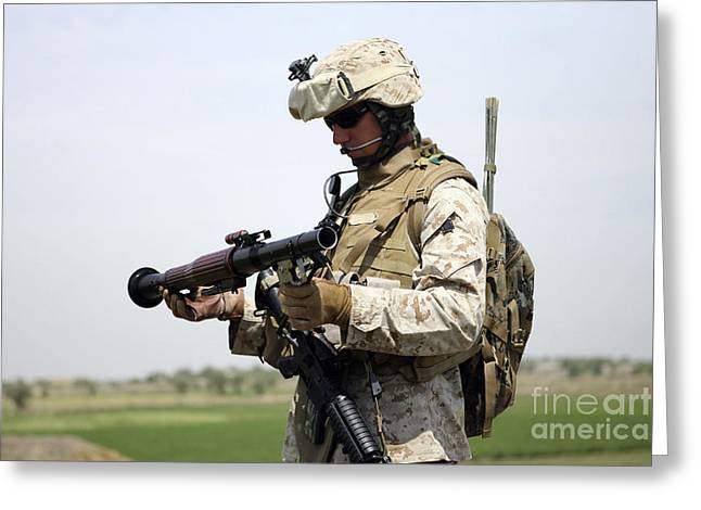 A Marine Looks At A Brand New Greeting Card by Stocktrek Images
