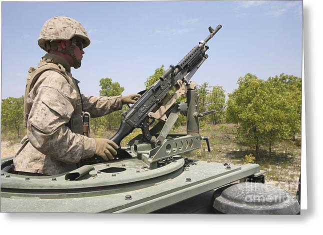 General Purpose Machine Guns Greeting Cards - A Marine Prepares To Fire His M240 Greeting Card by Stocktrek Images