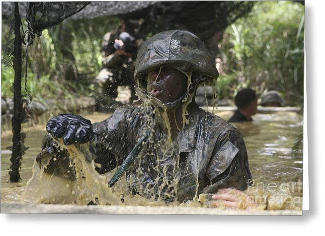 Jungle Warfare Greeting Cards - A Marine Splashes As He Makes His Way Greeting Card by Stocktrek Images