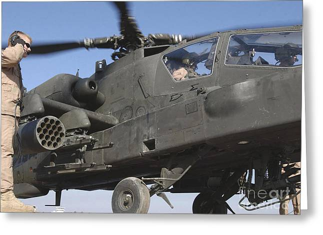Transceiver Greeting Cards - A Mechanic Stands Next To An Ah-64d Greeting Card by Stocktrek Images