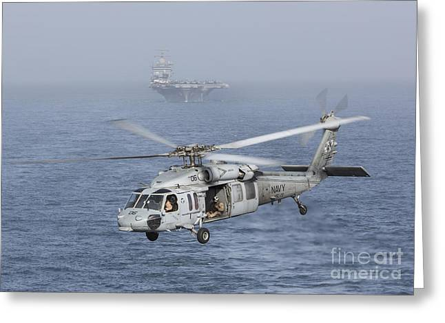 A Mh-60s Knighthawk Conducts A Vertical Greeting Card by Gert Kromhout