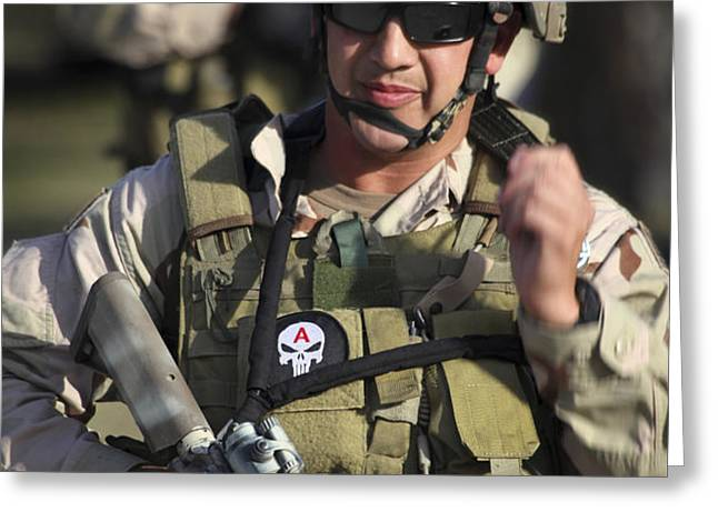 A Military Reserve Navy Seal Gives Greeting Card by Michael Wood
