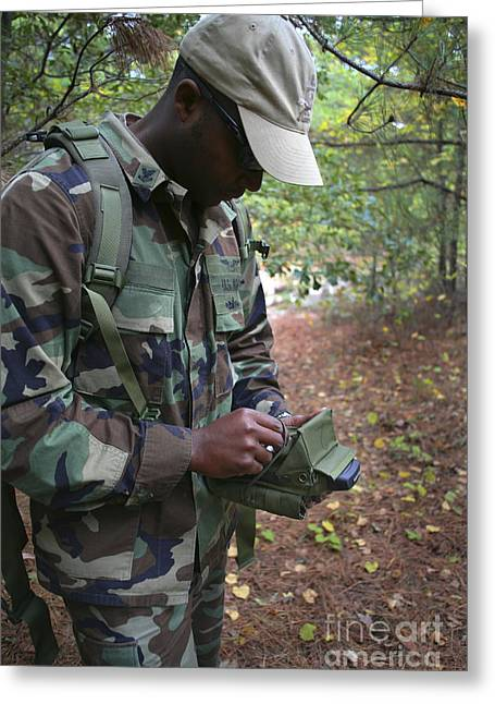Jungle Warfare Greeting Cards - A Military Technician Uses A Pda Greeting Card by Michael Wood