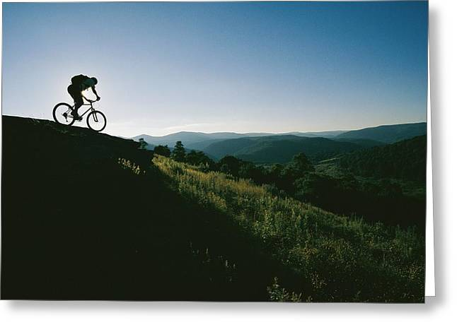 A Mountain Biker Heads Down A Hill Greeting Card by Skip Brown