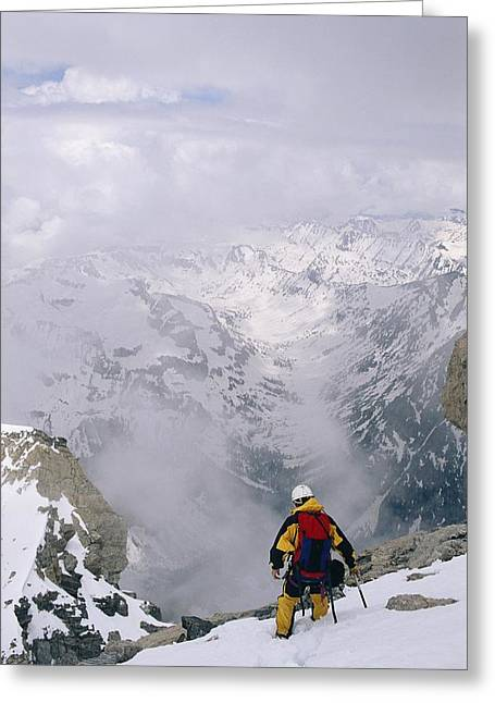 Knapsack Greeting Cards - A Mountaineer Descends Near The Summit Greeting Card by Gordon Wiltsie