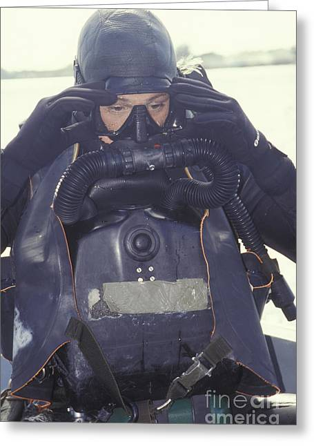 Navy Dress Greeting Cards - A Navy Seal Combat Swimmer Adjusts Greeting Card by Michael Wood