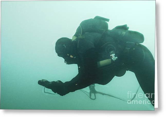 Scuba Diving Greeting Cards - A Navy Seal Combat Swimmer Navigates Greeting Card by Michael Wood