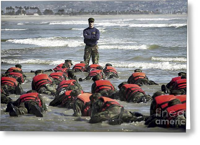 Physical Fitness Greeting Cards - A Navy Seal Instructor Assists Students Greeting Card by Stocktrek Images