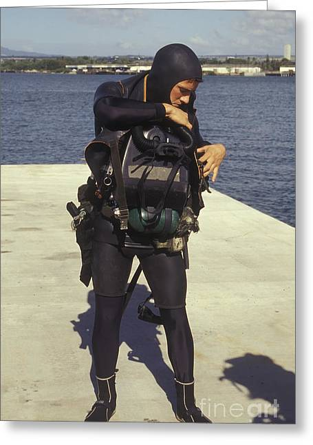 Navy Dress Greeting Cards - A Navy Seal Puts On Gear In Preparation Greeting Card by Michael Wood