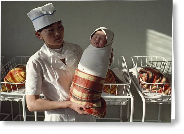 National Children Greeting Cards - A Nurse Holds A Tightly Wrapped Newborn Greeting Card by Dean Conger