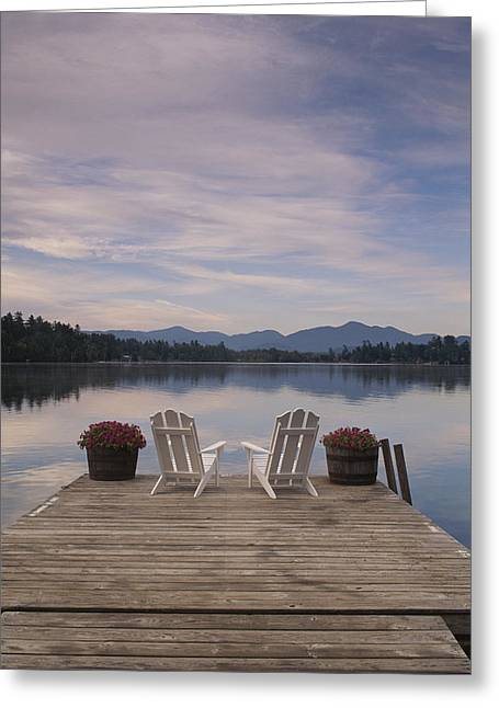 Benches And Chairs Greeting Cards - A Pair Of Adirondack Chairs On A Dock Greeting Card by Michael Melford
