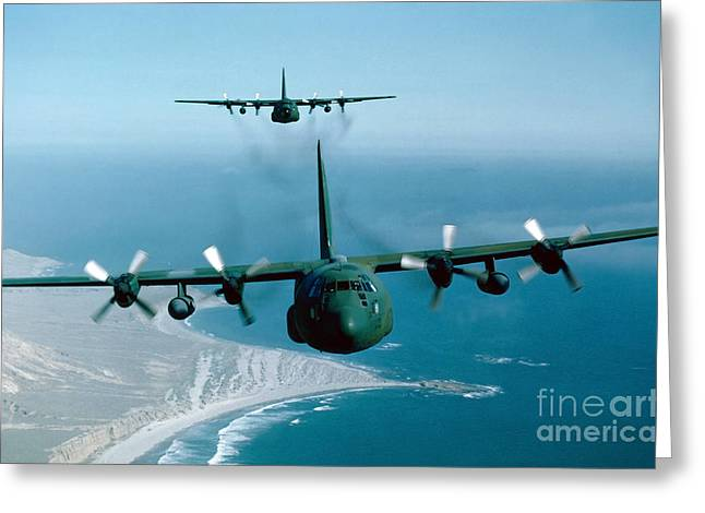 Cargo Planes Greeting Cards - A Pair Of C-130 Hercules In Flight Greeting Card by Stocktrek Images