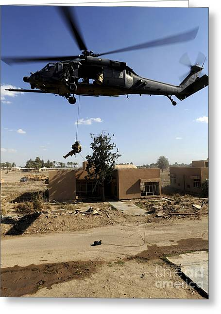 Urban Warfare Greeting Cards - A Pararescueman Rappels From An Hh-60 Greeting Card by Stocktrek Images