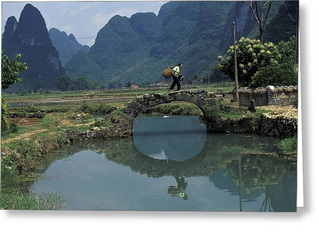 Rural Ways Of Life Greeting Cards - A Peasant Crosses A Stone Bridge Greeting Card by Raymond Gehman