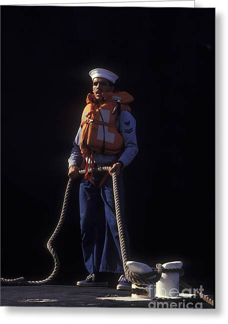 Life Jacket Greeting Cards - A Petty Officer Secures Rope Tied Greeting Card by Michael Wood