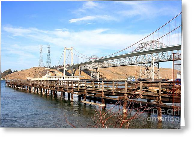 Pablo Greeting Cards - A Pier a Bridge and a Bridge Greeting Card by Wingsdomain Art and Photography