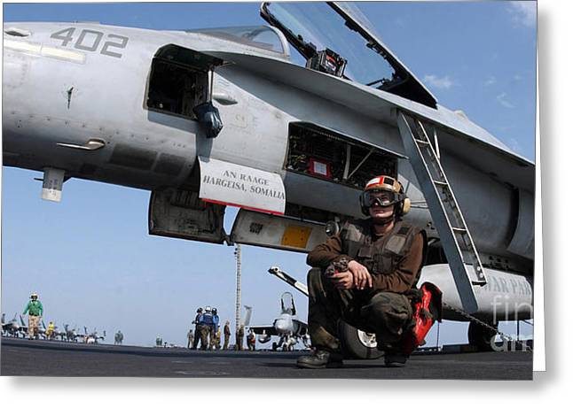 F-18 Greeting Cards - A Plane Captain Prepares For Flight Greeting Card by Stocktrek Images