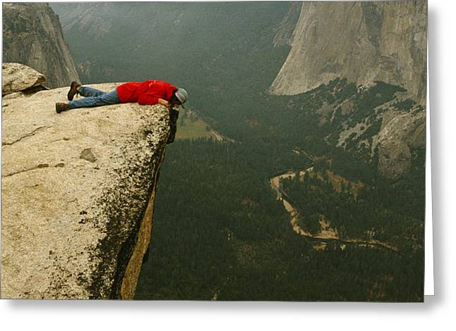 A Prone Man Peers Over Taft Point Greeting Card by Bill Hatcher