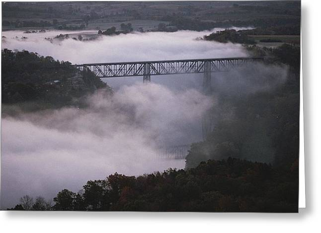 A Natural Bridge Greeting Cards - A Railroad Bridge Crosses A Fog-bound Greeting Card by Sam Abell
