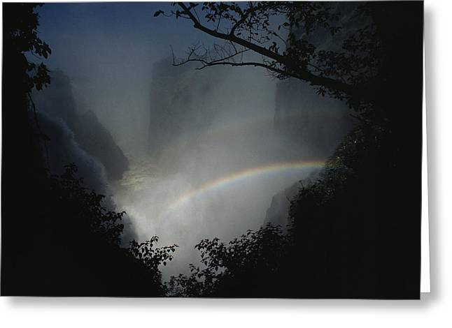 Fall River Scenes Greeting Cards - A Rainbow Arcs Across Victoria Falls Greeting Card by James L. Stanfield