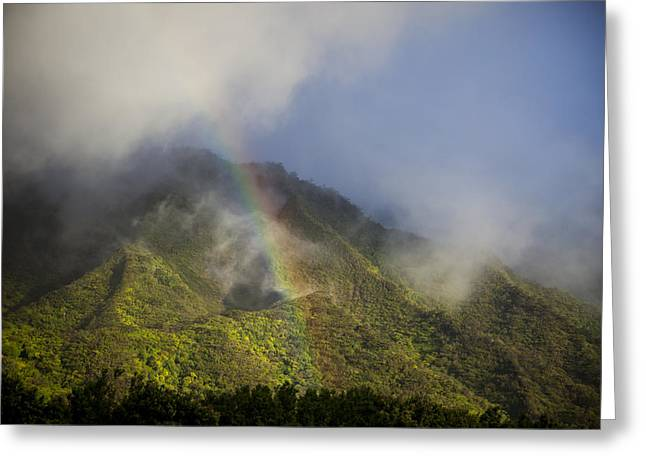 Tropical Oceans Greeting Cards - A Rainbow Shines Over The Rugged Greeting Card by Taylor S. Kennedy