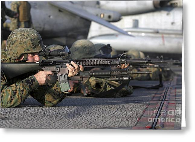 Uss Essex Greeting Cards - A Rifleman Fires His M16 A4 Service Greeting Card by Stocktrek Images