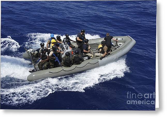 Boats On Water Greeting Cards - A Rigid-hull Inflatable Boat Carrying Greeting Card by Stocktrek Images